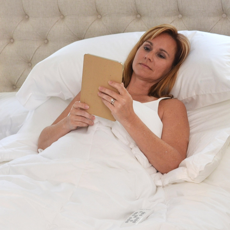 Photo of a woman reading on the Flexabed Premier bed.